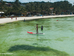 white beach sitio de stand up paddle / paddle surf en Filipinas